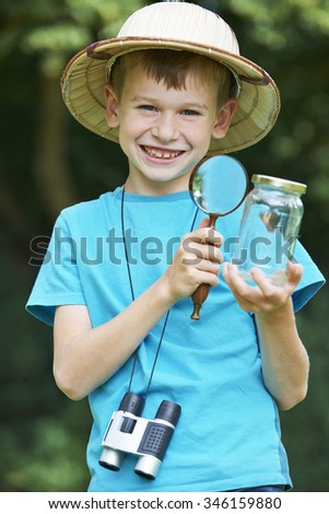 Young Boy Studying Butterfly Caught In Jar
