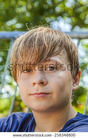 young boy sweating and exhausted from sports - stock photo