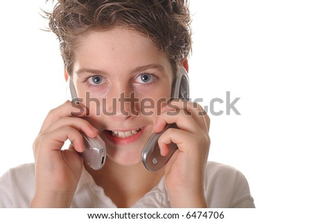 young boy talking on two cell phones - stock photo