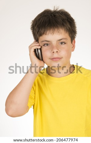 Young boy talking with mobile isolated on white background - stock photo