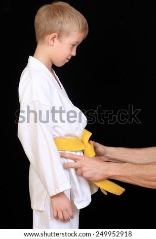 Young boy training karate - stock photo