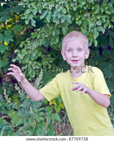 Young boy trying to frighten - stock photo