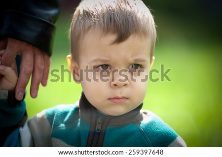 Young boy walking in the park portrait. - stock photo