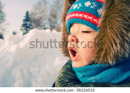 Young boy want to sneeze outdoor. - stock photo