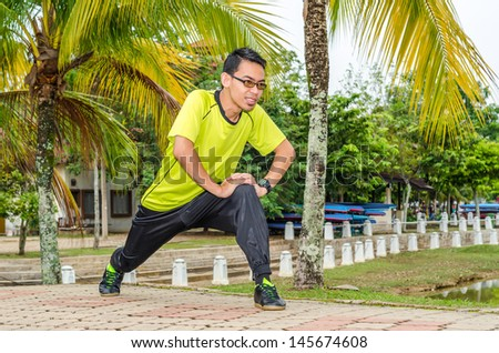 Young boy warming up in the park - stock photo