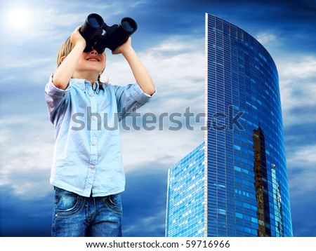 Young boy watch in the field-glass, outdoors.
