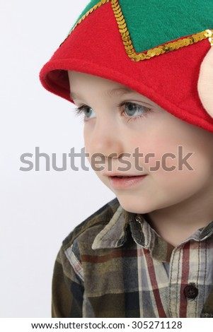 Young boy wearing a christmas elf hat - stock photo