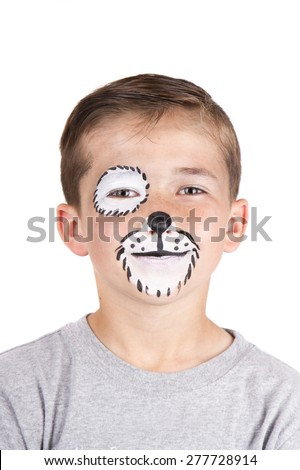Young boy wearing dog carnival face paint isolated on white - stock photo
