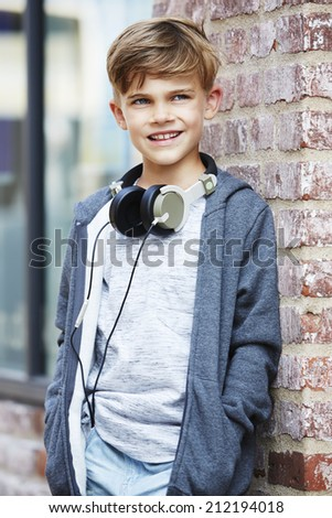 Young boy wearing headphones, looking away  - stock photo