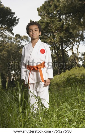 Young boy wearing karate outfit - stock photo