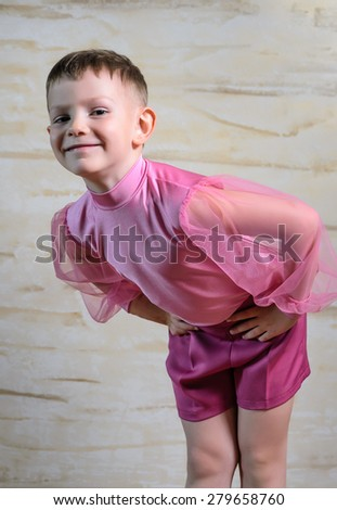 Young Boy Wearing Pink Dance Costume Taking a Bow with Hands on Hips, Portrait of Traditional European Dancer Looking at Camera in Studio