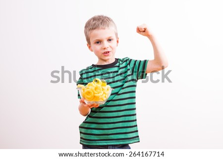 Young boy with a bowl of chips - stock photo