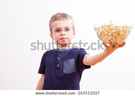 Young boy with a bowl of popcorn