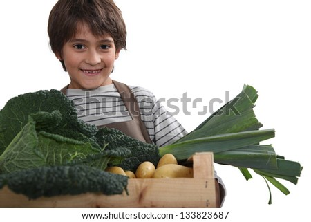 Young boy with a box full of fresh produce