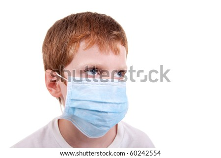 young boy with a medical mask, isolated on white, studio session