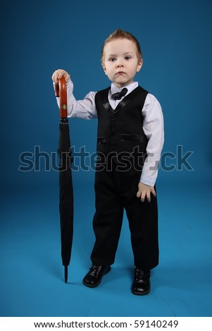 young boy with an black umbrella - stock photo