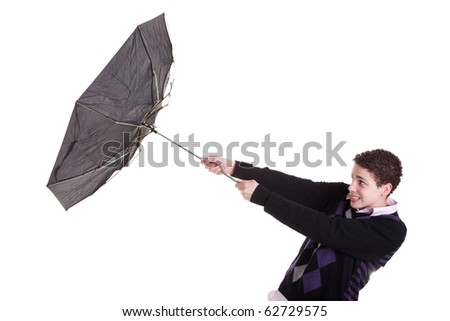Young boy with an umbrella turned by the wind, isolated on white, studio shot - stock photo