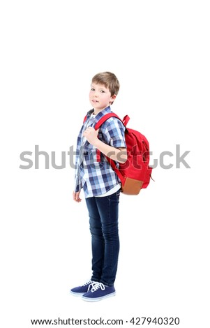 Young boy with backpack on a white background - stock photo