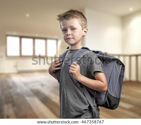 Young boy with backpack proud and ready to go back to school