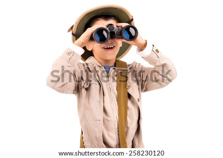Young boy with binoculars playing Safari isolated in white