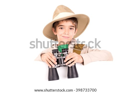 Young boy with binoculars playing Safari isolated over a blank board