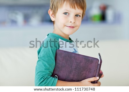 Young boy with book - stock photo
