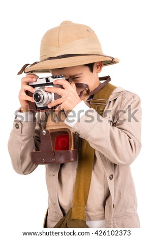 Young boy with camera playing Safari isolated in white