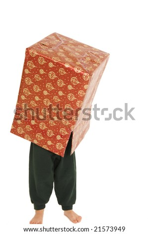 Young boy with Christmas box on his head. Isolated on white.