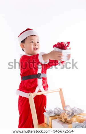 Young boy with Christmas gift. holidays, presents, christmas, x-mas, birthday concept - Asian child  boy with gift box - stock photo