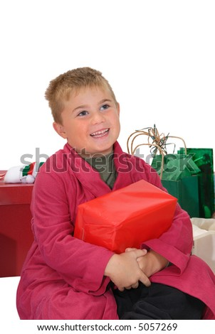 Young boy, with Christmas present on his lap, looking up with a happy, grateful expression, isolated on white - stock photo