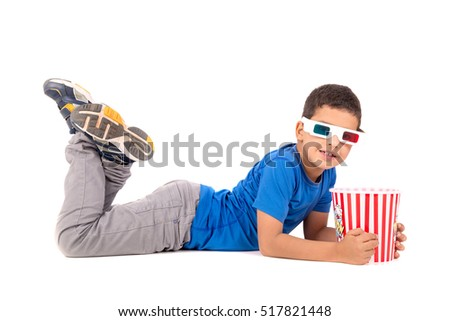 Young boy with 3d glasses and popcorn isolated in white