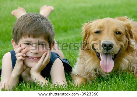 Young Boy With Dog - stock photo