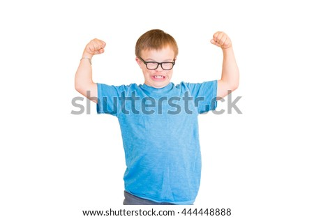 Young Boy With Downs Syndrome Flexing His Muscles - stock photo