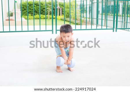 Young boy with dumb Bell - stock photo