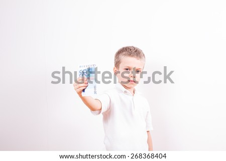 Young boy with euro money - stock photo
