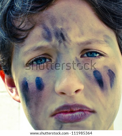 Young boy with face paint. - stock photo