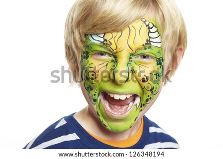 Young boy with face painting monster smiling on white background - stock photo