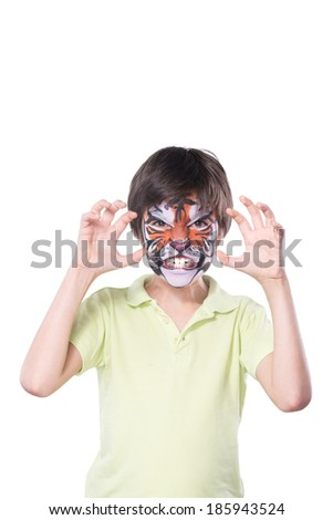 Young boy with face painting of a tiger