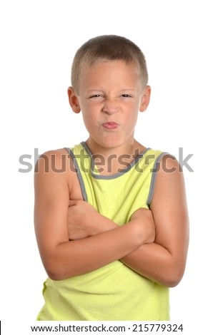 young boy with facial pouting expression isolated on white background - stock photo