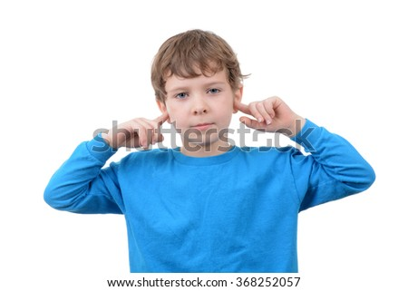 young boy with finger in ears isolated white background