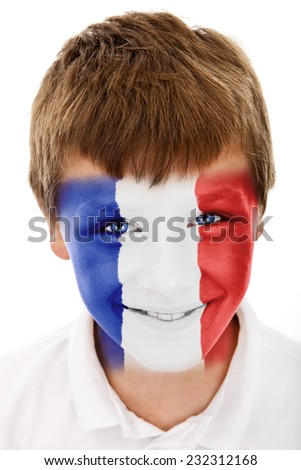 Young boy with France flag painted on his face - stock photo