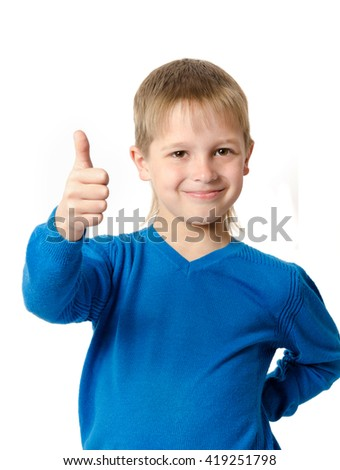 Young boy with gesture thumb up isolated on white - stock photo