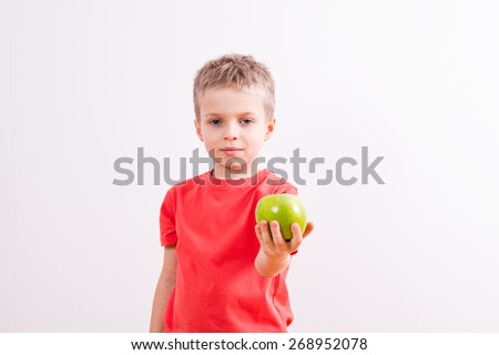 Young boy with green apple  - stock photo