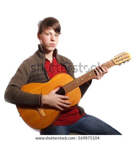 young boy with guitar on white background - stock photo