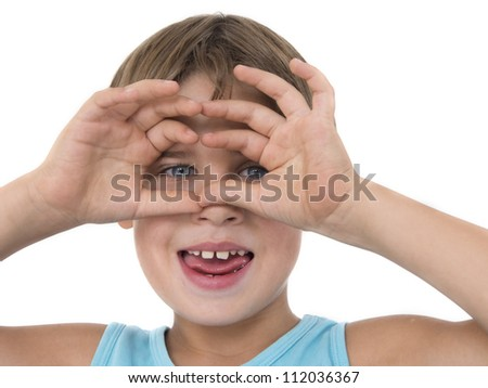 young boy with hands on the face,