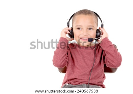 young boy with headphones isolated in white background