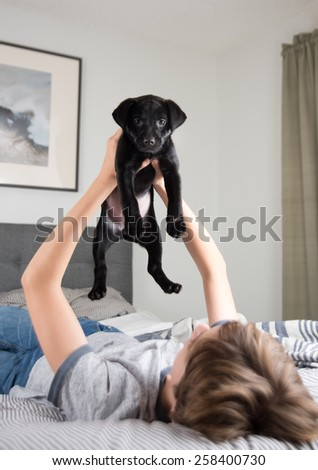 Young Boy with His New Puppy - stock photo