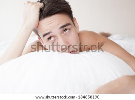 Young boy with lack of sleep. Sleeping disorder. - stock photo