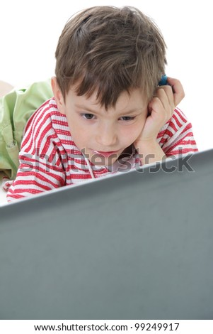 young boy with laptop over white