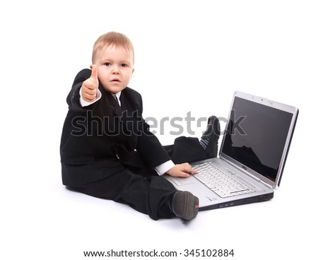 young boy with laptop showing thumbs up at camera isolated on white background - stock photo